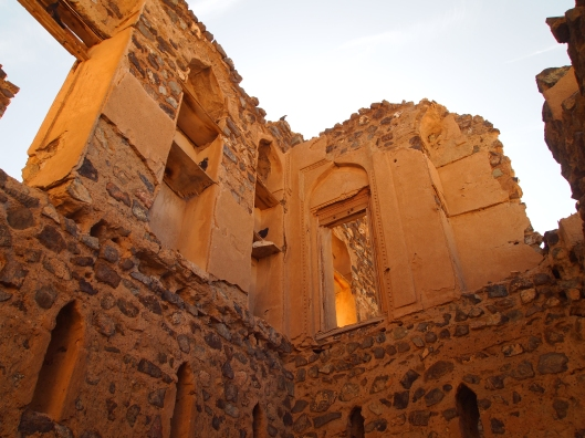 Looking up at the ruins of Munisifeh in Ibra, Oman