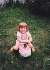 Sarah rides a pink shoe
