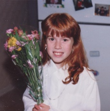 Sarah gets flowers after her performance of Alice in Wonderland
