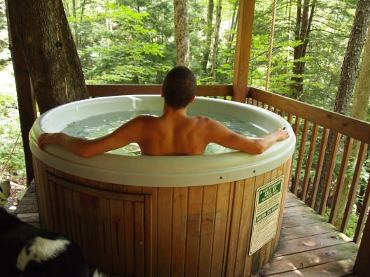 an escape into a nice relaxing hot tub on the deck of the cabin
