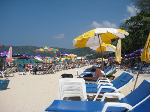 another crowded and tacky beach in Phuket, Thailand