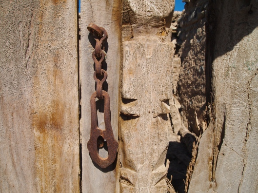 a lock and chain on a door in the ruins of Ibra's old souq