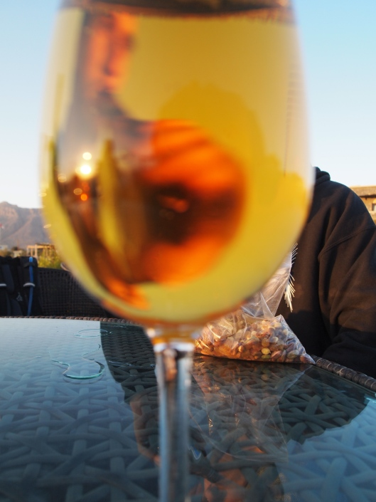 Alex is behind the glass, so covered completely, but you can see his face in the foreground in the wine glass