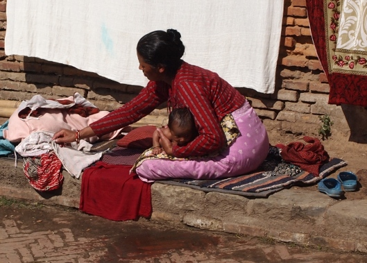 A mother bathes her child in Bhaktapur, Nepal