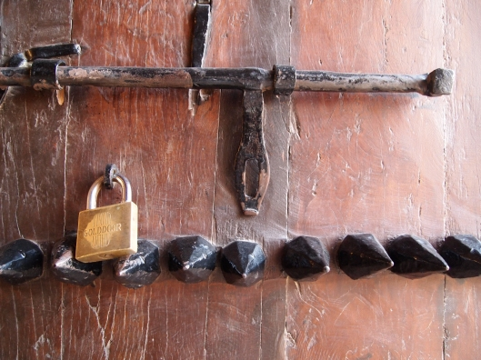 Lock, bar and spikes at Nakhal Fort, Oman