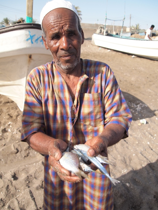 Omani fisherman at Al Musanaah Beach, Oman