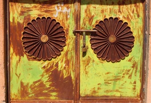 metal bar and lock on a metal door in Yanqul, Oman