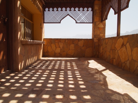 shadow play in a building near the entrance of Wekan that looks like it was once a ticket booth