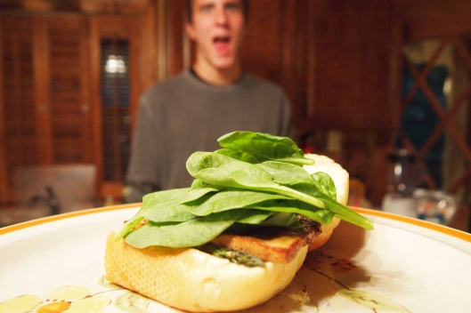 there's Adam, all blurry in the background, mouth watering  over his vegan sandwich