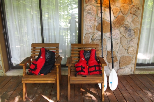 Life jackets and kayak paddles ready to go