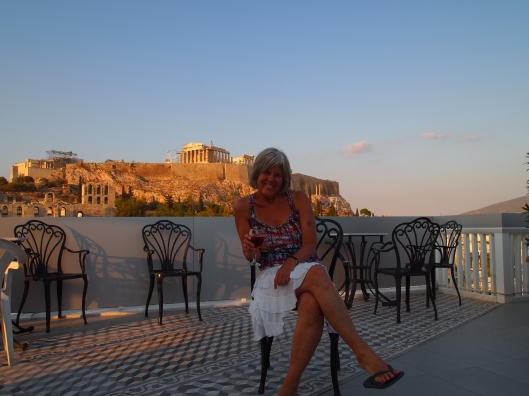 me sitting on the roof of the Acropolis View Hotel