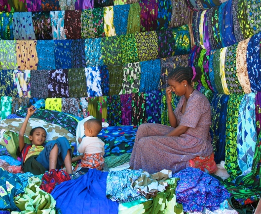 a mother and her children at the Lalibela Saturday market in Ethiopia