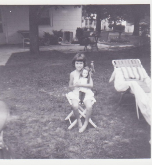 me with my Dorothy doll in my grandmother's backyard