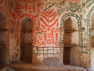 painted rooms in the restored section of ruins
