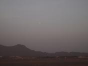 the moon through the haze